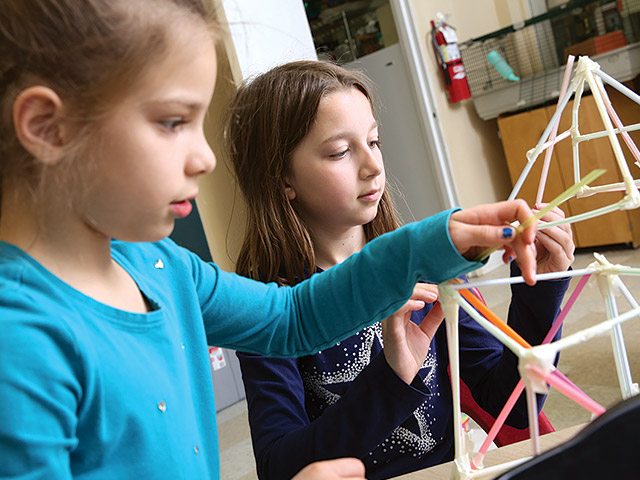 Taylor School Elementary Explorers building with straws in classroom